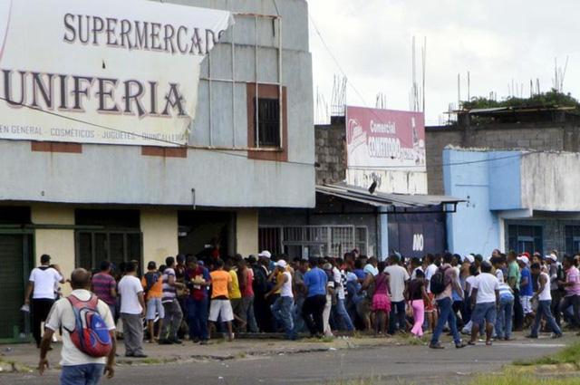 Nạn cướp lương thực hoành hành ở Venezuela - Ảnh 1.