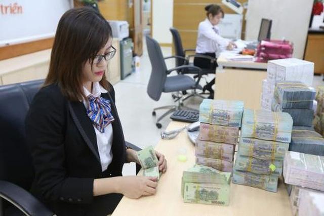 4 ngân hàng lớn cam kết hạ lãi suất cho vay hỗ trợ doanh nghiệp - Ảnh 1.