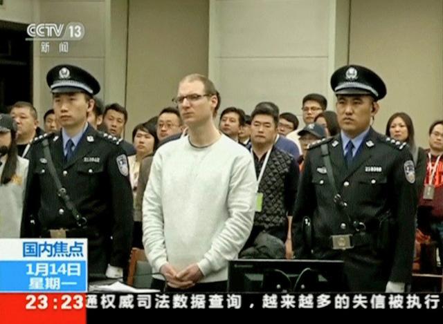 Trung Quốc trả đũa, phát cảnh báo người dân đề phòng khi tới Canada - Ảnh 1.