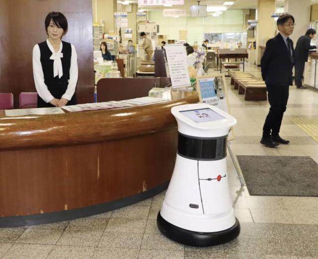 Robot công chức giúp dân làm giấy tờ - Ảnh 1.