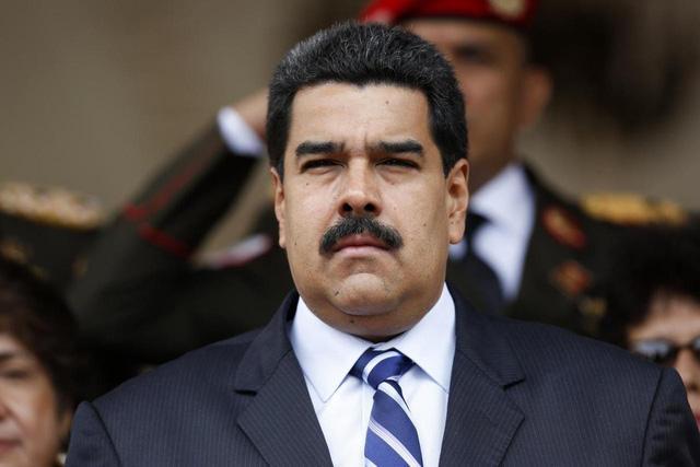 Mỹ khuyến cáo người dân không đến Venezuela - Ảnh 1.