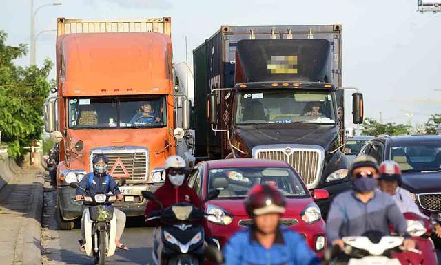 Phó thủ tướng Trương Hòa Bình: 23 tuổi lái xe container không được đâu - Ảnh 1.