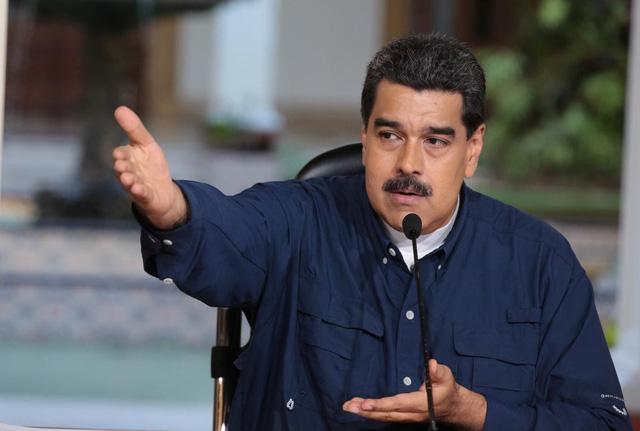 Mỹ phạt ngân hàng chủ chốt Venezuela vì ủng hộ ông Maduro - Ảnh 1.