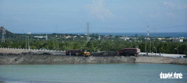 Nhiệt điện Vĩnh Tân 1 xả nước ra biển khi chưa được cấp phép - Ảnh 4.