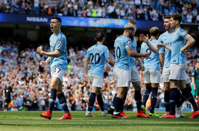 Đá bại Tottenham, Man xanh trở lại đỉnh bảng - Ảnh 1.