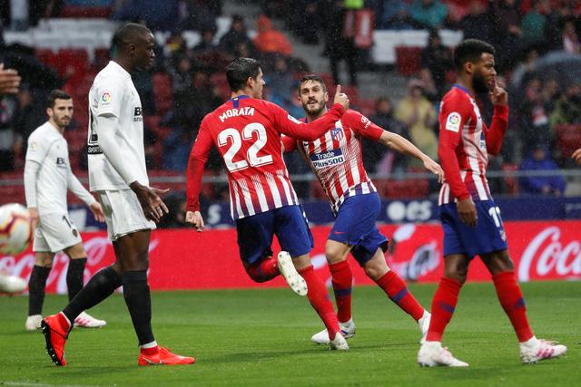 Atletico Madrid ngăn không cho Barcelona vô địch sớm - Ảnh 1.