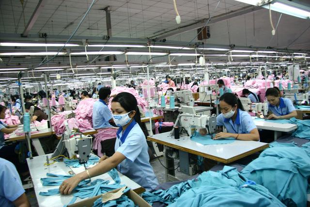 Xuất khẩu hơn 36 tỉ USD, dệt may vẫn bế tắc nguồn nguyên liệu - Ảnh 1.