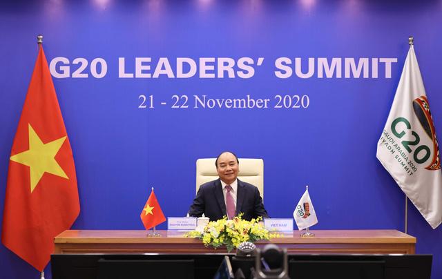 Thủ tướng Nguyễn Xuân Phúc kêu gọi các nước đoàn kết vượt qua COVID-19 tại G20 - Ảnh 1.