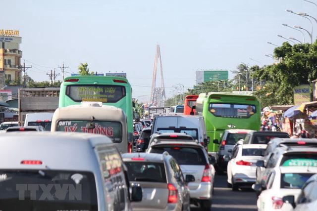 Cấm ô tô tải từ 3 trục trở lên lưu thông qua cầu Rạch Miễu hai ngày cuối tuần - Ảnh 1.