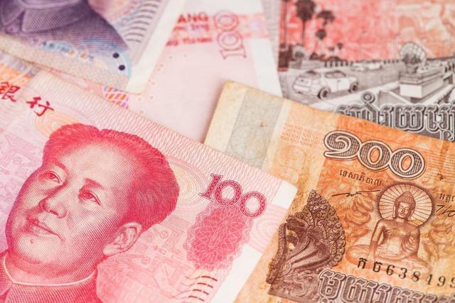 Campuchia và Trung Quốc sử dụng đồng nội tệ trong giao dịch lúa gạo - Ảnh 1.