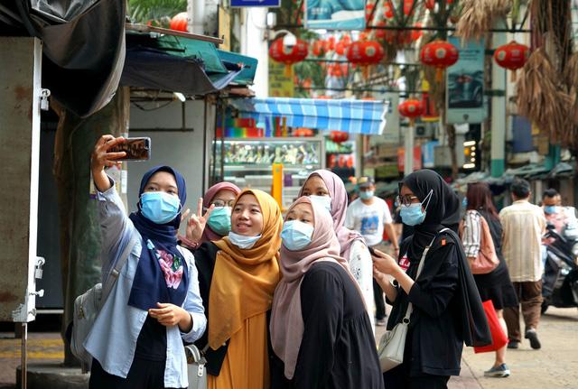 Malaysia bùng nổ du lịch nội địa sau khi dỡ bỏ hạn chế đi lại - Ảnh 1.