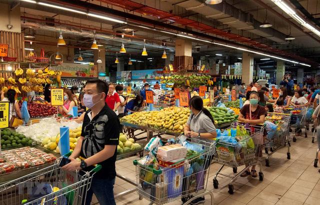 Malaysia cho bán hàng giá rẻ phục hồi kinh tế hậu COVID - Ảnh 1.