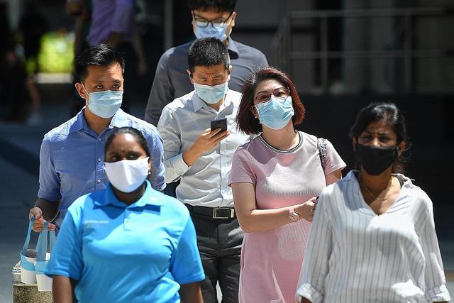 Singapore chuẩn bị cho sống chung lâu dài với COVID-19 - Ảnh 1.