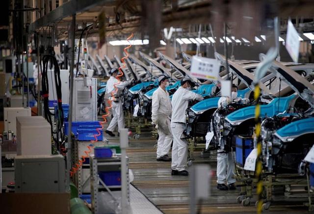 Hoạt động chế tạo ở châu Á gặp khó do chi phí tăng và biến thể Delta - Ảnh 1.