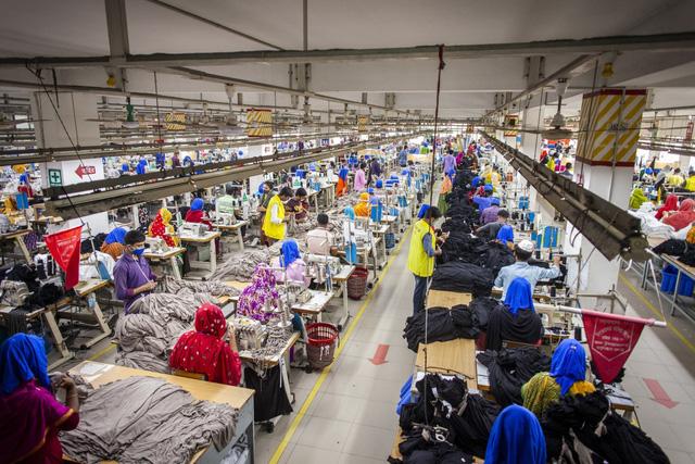 Hoạt động của các nhà máy ở châu Á chững lại do dịch bệnh - Ảnh 1.