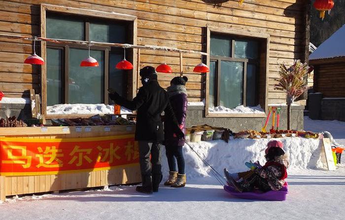 Ngôi làng tuyết trắng đẹp như trong cổ tích ở Cáp Nhĩ Tân - Ảnh 10.