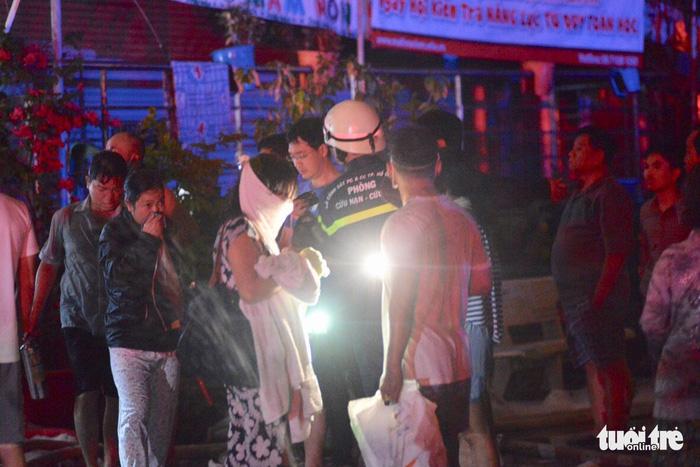 Cháy chung cư Carina tại Sài Gòn, 13 người chết - Ảnh 6.
