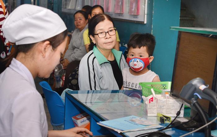 1,6 triệu dân TP.HCM phải đổi thẻ bảo hiểm y tế mẫu mới - Ảnh 1.