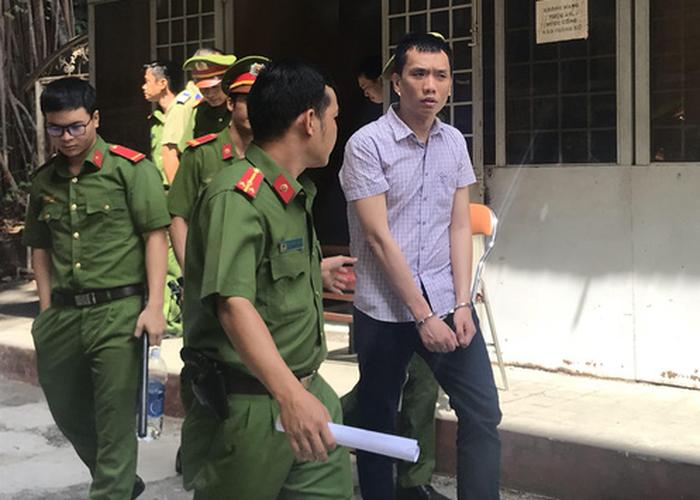 Xét xử cựu công an tội gián điệp, dọa bán tài liệu mật cho Trung Quốc - Ảnh 1.