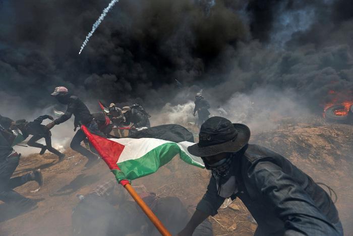 Thế giới lên án Mỹ và Israel làm bùng phát bạo lực ở Gaza - Ảnh 1.