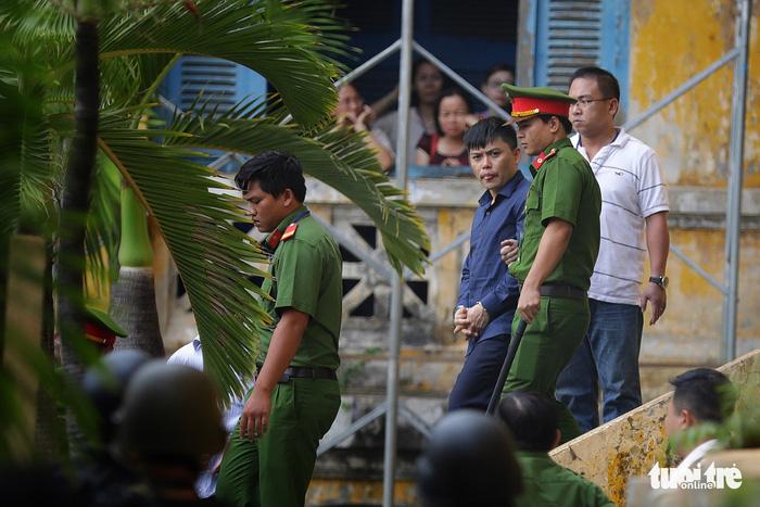 Y án sơ thẩm với nhóm khủng bố sân bay Tân Sơn Nhất - Ảnh 1.