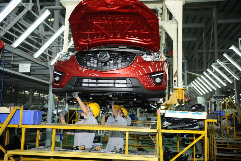 Mazda tăng giá bán trong cơn bão giảm giá xe hơi - Ảnh 2.