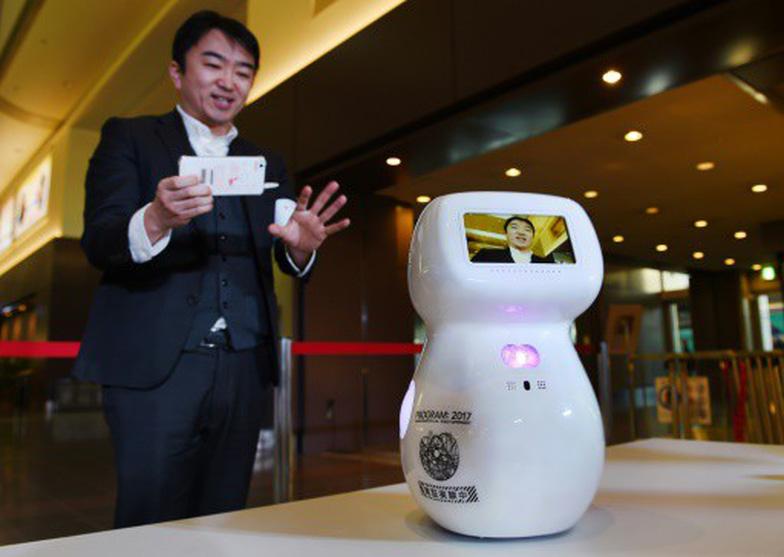 Sân bay Tokyo sẽ 'la liệt' robot phục vụ trong Olympic 2020 - Ảnh 1.