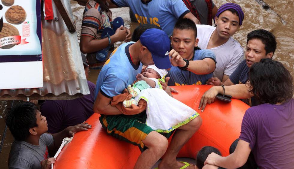 Thế giới trong tuần qua ảnh: bão Tembin tàn phá Philippines - Ảnh 2.