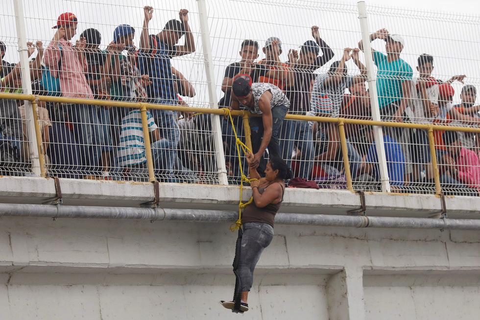 Rợn người với cuộc di cư liều lĩnh hướng vào Mỹ - Ảnh 7.