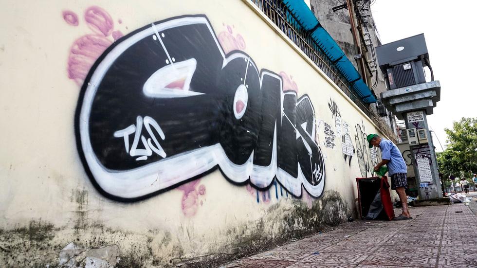 Tranh tường, graffiti và... bôi bẩn đường phố - Ảnh 11.