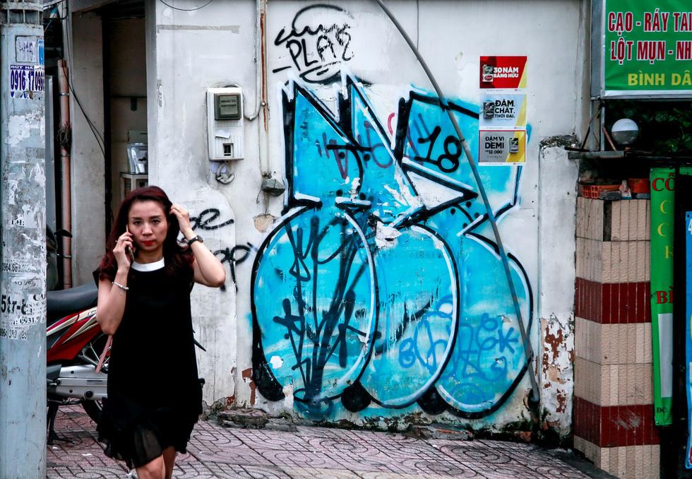Tranh tường, graffiti và... bôi bẩn đường phố - Ảnh 7.