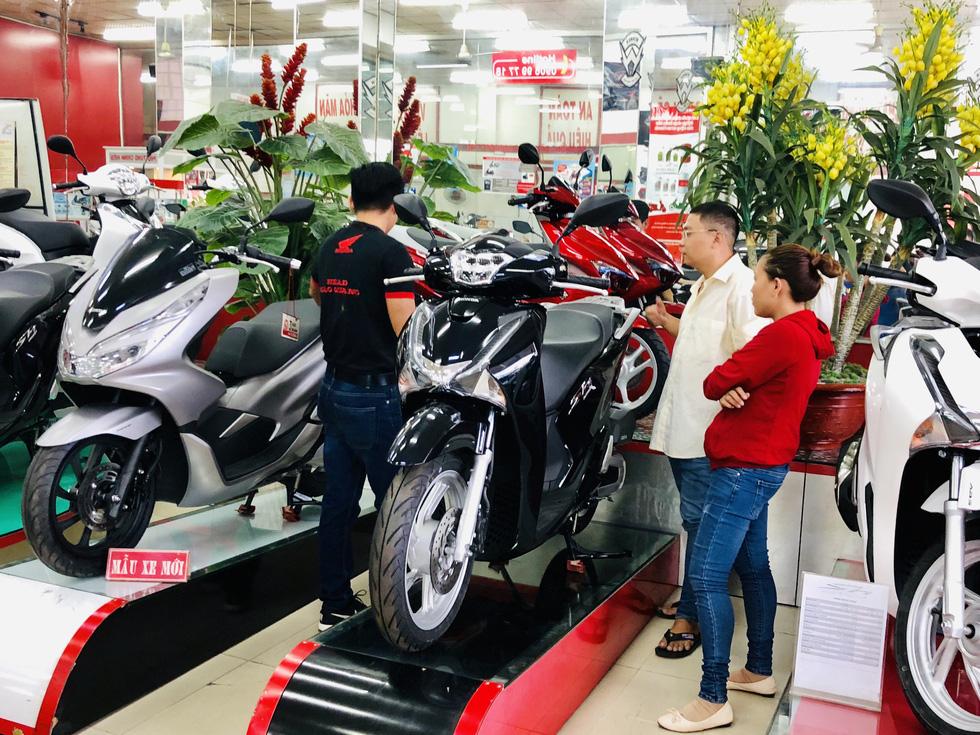 Tiêu thụ giảm nhưng người Việt vẫn mua khoảng 250.000 xe máy/tháng - Ảnh 1.