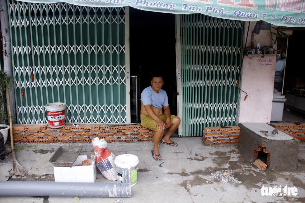 Khốn khổ vì bụi bặm, bẫy ổ gà trên đường Huỳnh Tấn Phát - Ảnh 12.