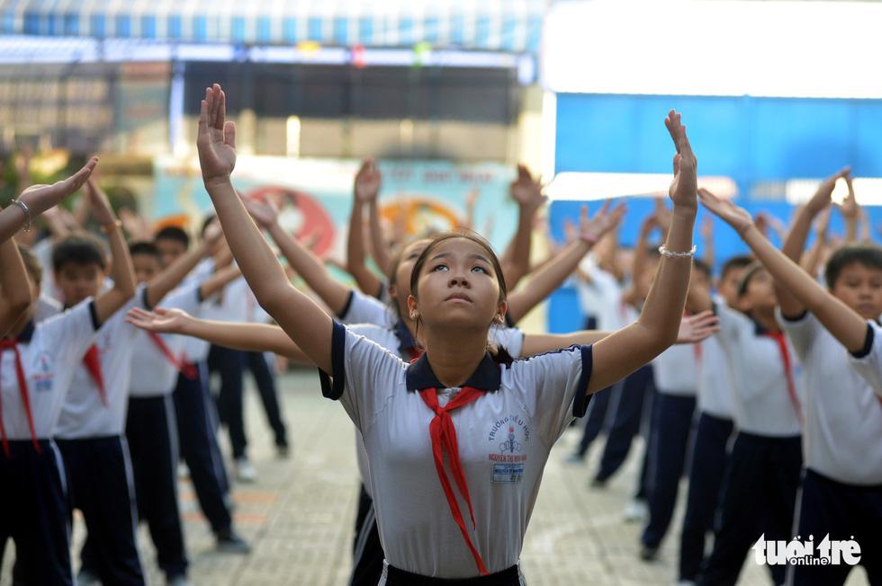 Học trò Sài Gòn thích thú tập thể dục với nhạc võ Vovinam - Ảnh 6.