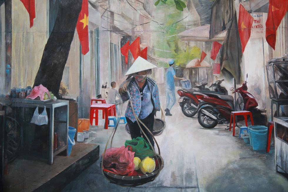Phố bích họa Phùng Hưng điểm đến mới của Hà Nội dịp tết - Ảnh 10.