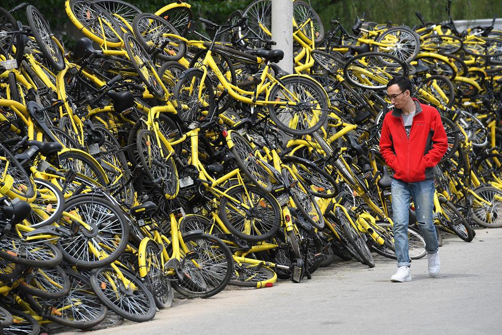 Những núi xe đạp bị vứt bỏ ở Trung Quốc - Ảnh 4.