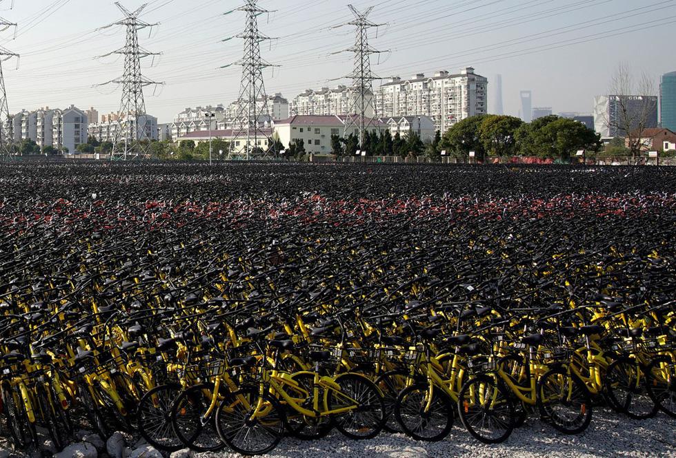 Những núi xe đạp bị vứt bỏ ở Trung Quốc - Ảnh 11.