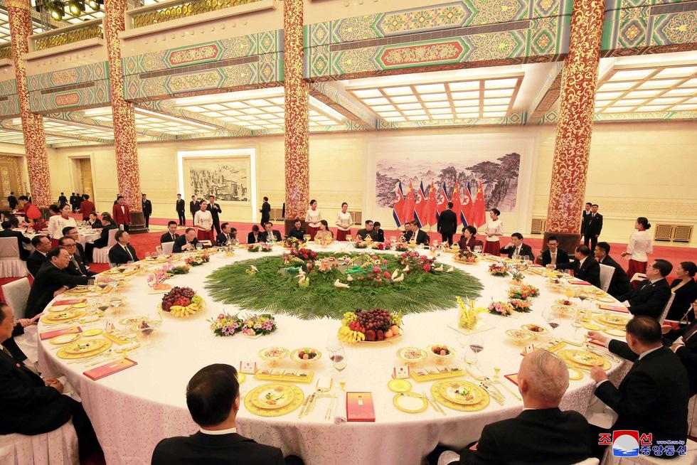 Hình ảnh chuyến thăm lịch sử của ông Kim Jong Un tại Trung Quốc - Ảnh 10.