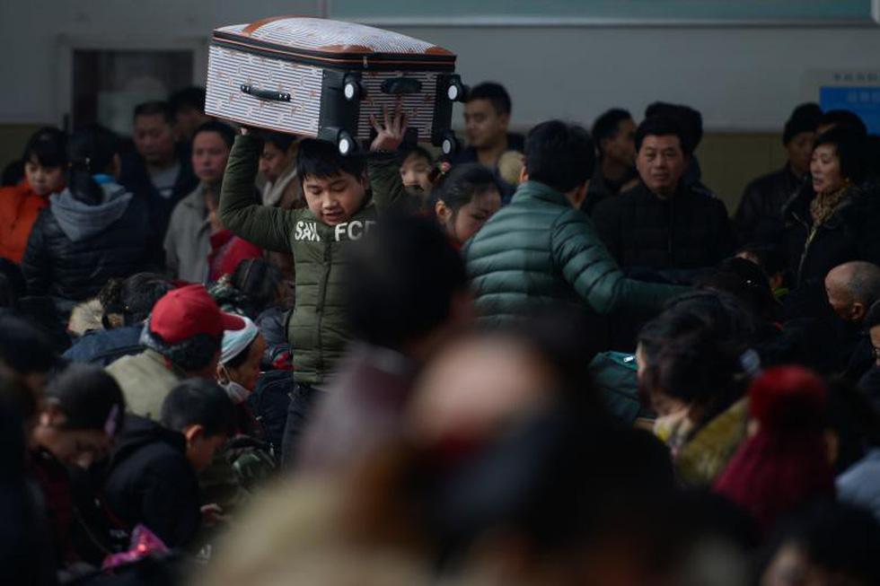 2,98 tỉ lượt dân Trung Quốc ùn ùn về quê ăn Tết - Ảnh 4.