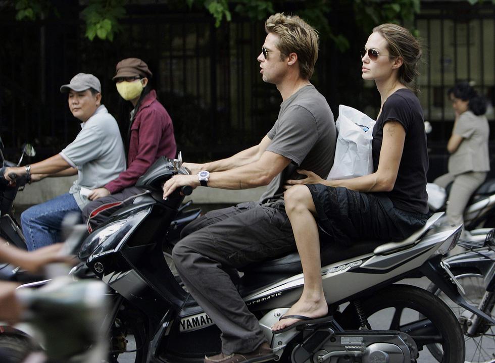 Brad Pitt và Angelina Jolie: 12 năm hội ngộ rồi chia ly... - Ảnh 11.