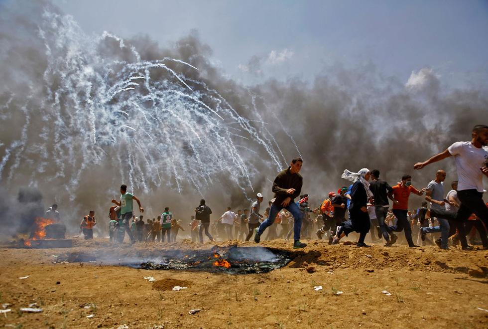 Ngày trở về đẫm máu và nước mắt của người Palestine - Ảnh 8.