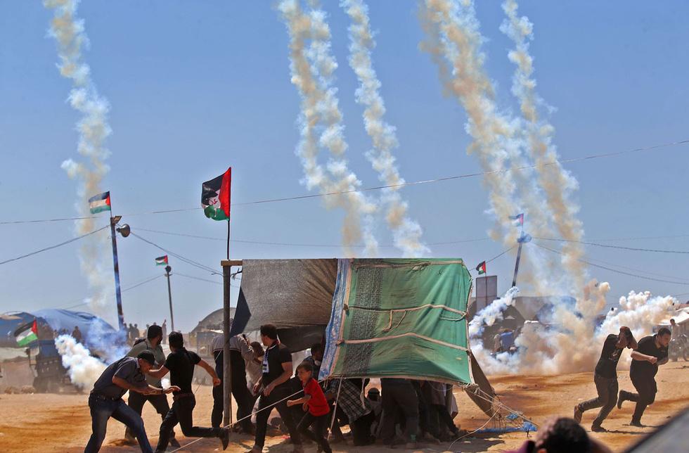 Ngày trở về đẫm máu và nước mắt của người Palestine - Ảnh 10.
