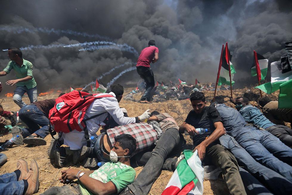 Ngày trở về đẫm máu và nước mắt của người Palestine - Ảnh 12.