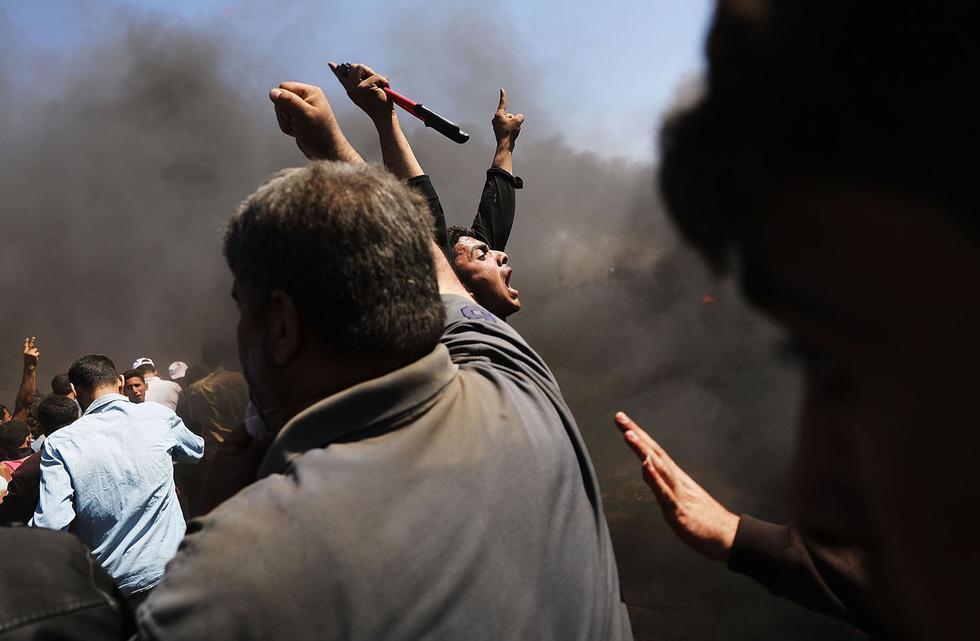 Ngày trở về đẫm máu và nước mắt của người Palestine - Ảnh 13.