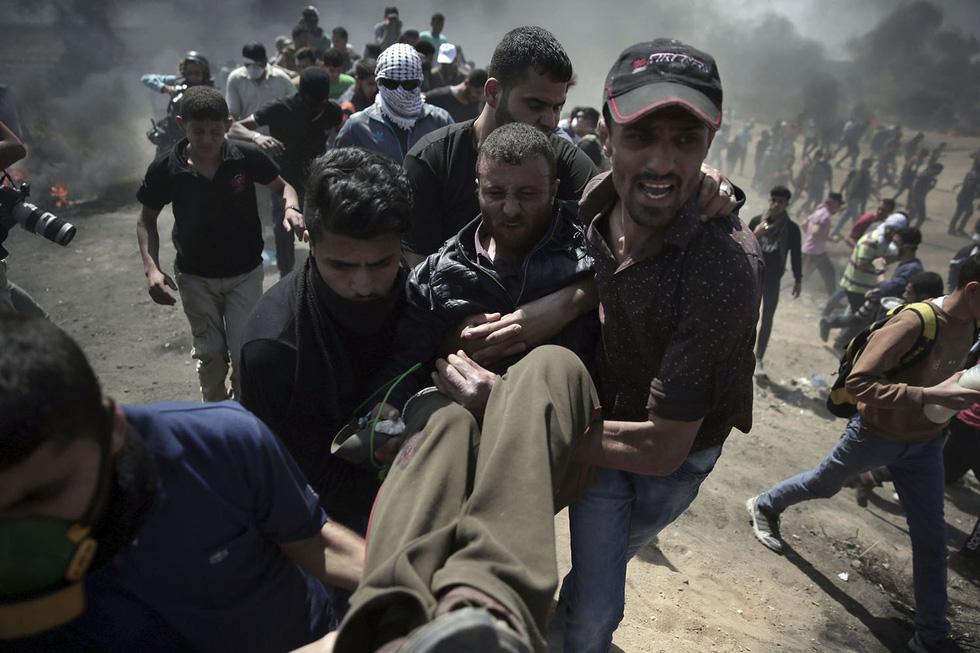 Ngày trở về đẫm máu và nước mắt của người Palestine - Ảnh 17.
