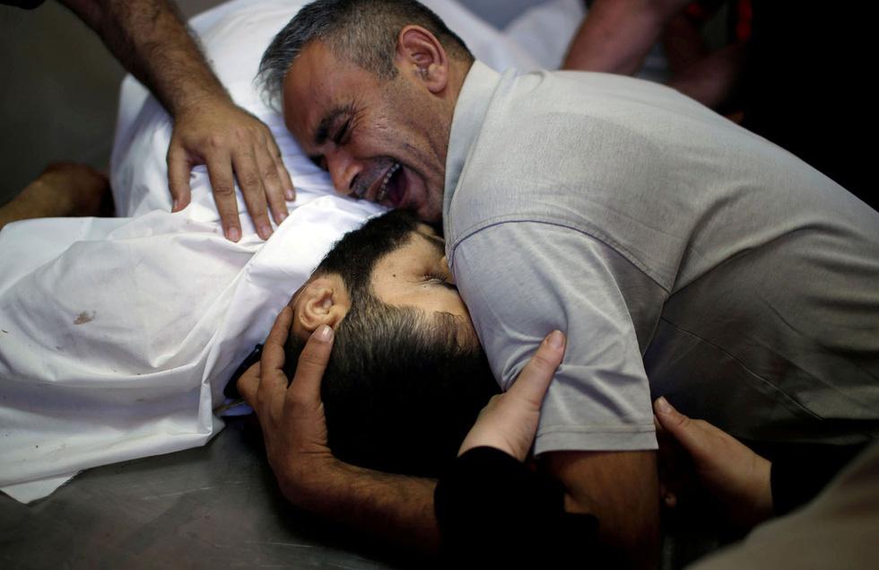 Ngày trở về đẫm máu và nước mắt của người Palestine - Ảnh 20.