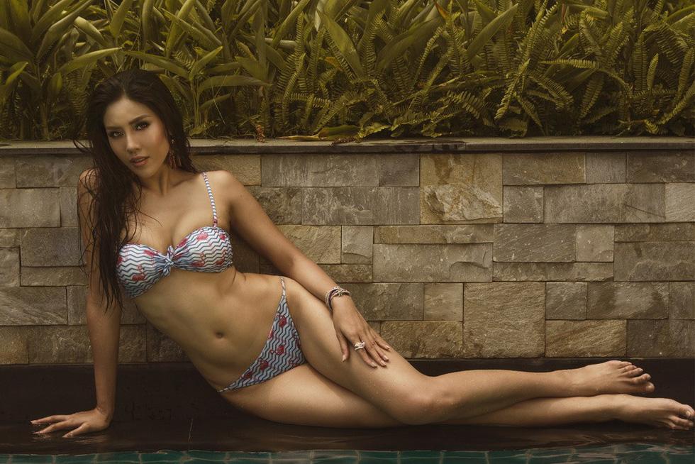 Á hậu Nguyễn Thị Loan nóng bỏng với bikini rực rỡ sắc hè - Ảnh 6.