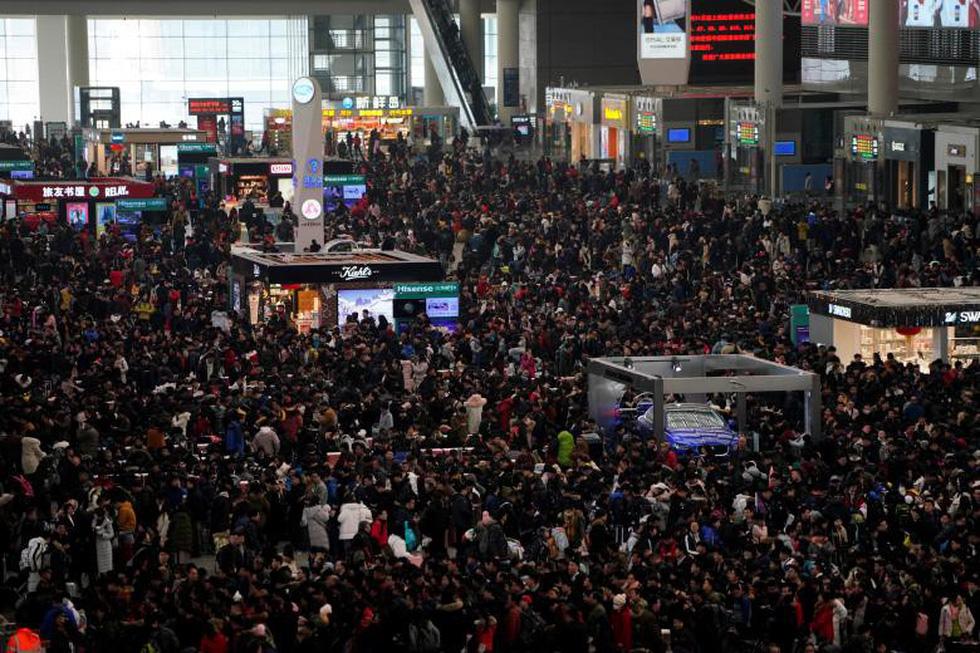 2,98 tỉ lượt dân Trung Quốc ùn ùn về quê ăn Tết - Ảnh 6.