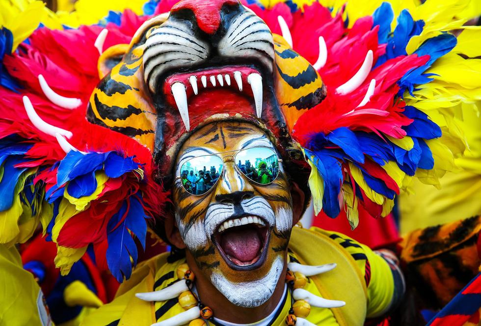 Fan World Cup ấn tượng với khuôn mặt nhiều sắc màu - Ảnh 14.