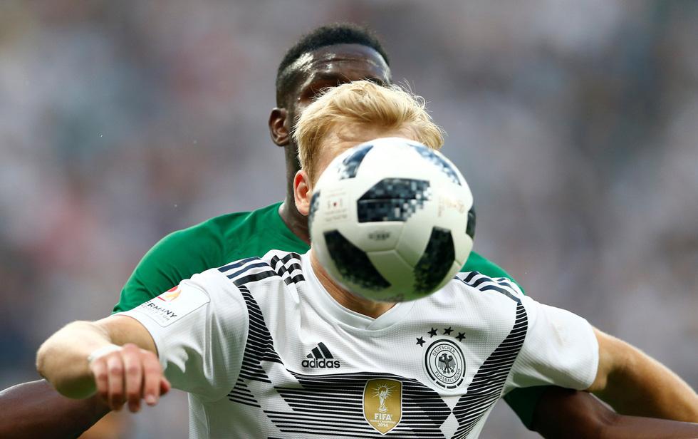 Thế giới trong tuần qua ảnh: World Cup và thượng đỉnh Mỹ Triều phủ khắp các mặt báo - Ảnh 7.